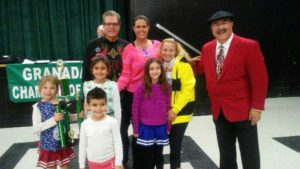 """Honorary Mayor of Granada Hills, Dr. Carl Melnik presenting the John V Ciccarelli Founder Sweepstakes Parade Award for """"Best Use of Parade Theme"""" to School Spirit Cheer Calabash Serrania - Welby Way   (The 2016 Parade Theme - Favorite Ugly Holiday Sweaters and Christmas Ties!)"""